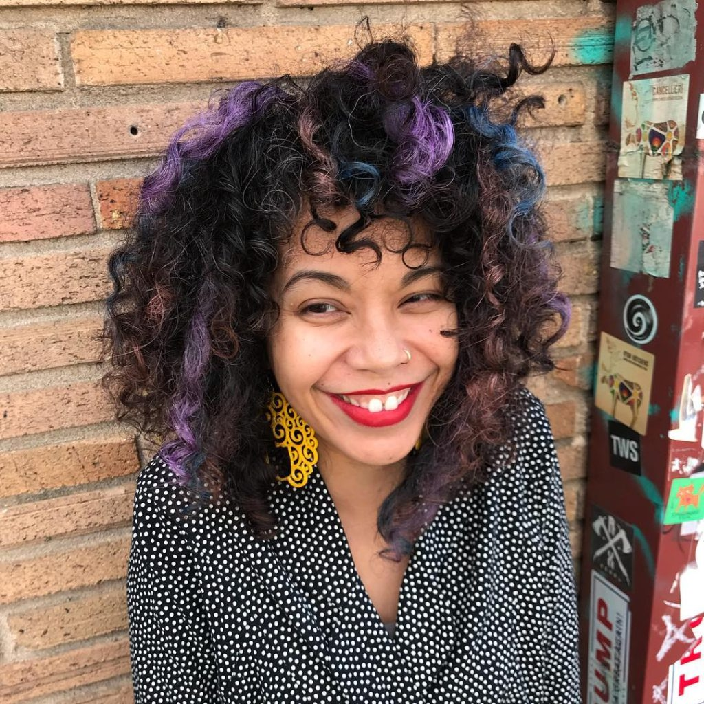 Voluminous Bohemian Fro with Wild Undone Curly Texture and Rainbow Highlights Medium Length Hairstyle