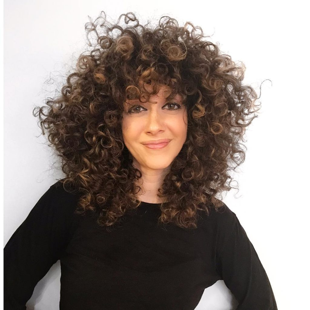 Voluminous Brunette Textured Cut with Spiral Curls and Highlights Medium Length Hairstyle