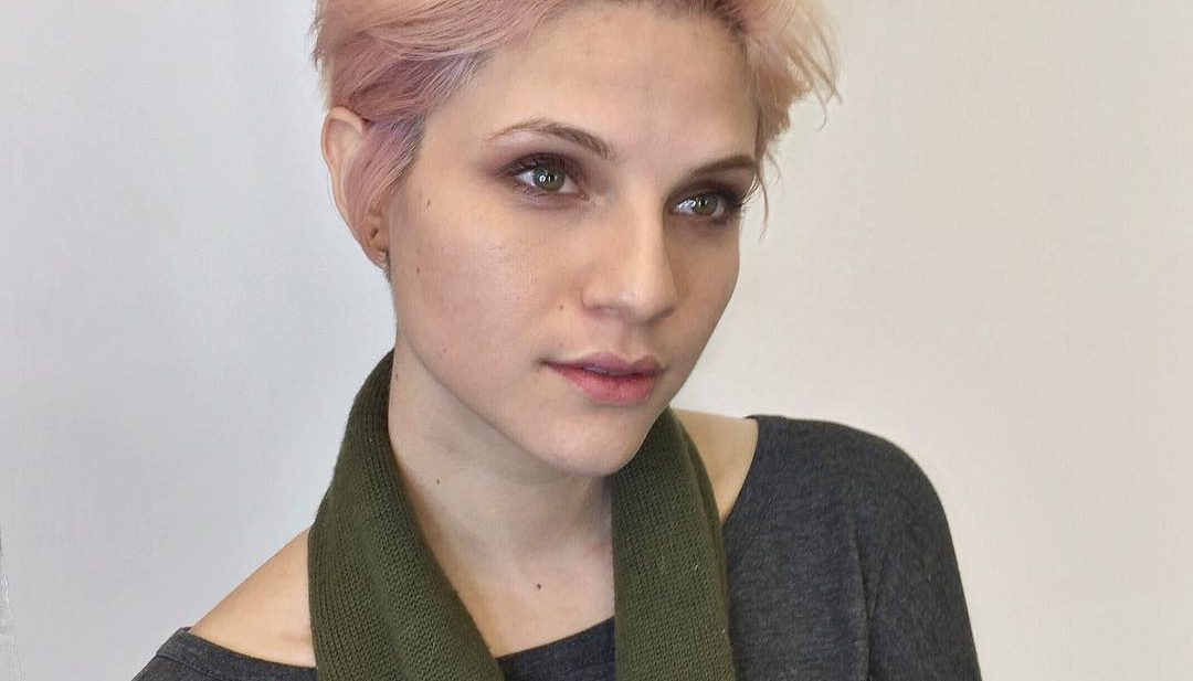 Voluminous Brushed Up Pixie with Messy Blowout Texture and Baby Pink Hair Color Short Fall Hairstyle