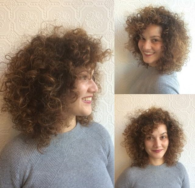 Voluminous Tousled Curly Bob with Curly Side Swept Bangs and Sun Kissed Caramel Ombre Medium Length Hairstyle