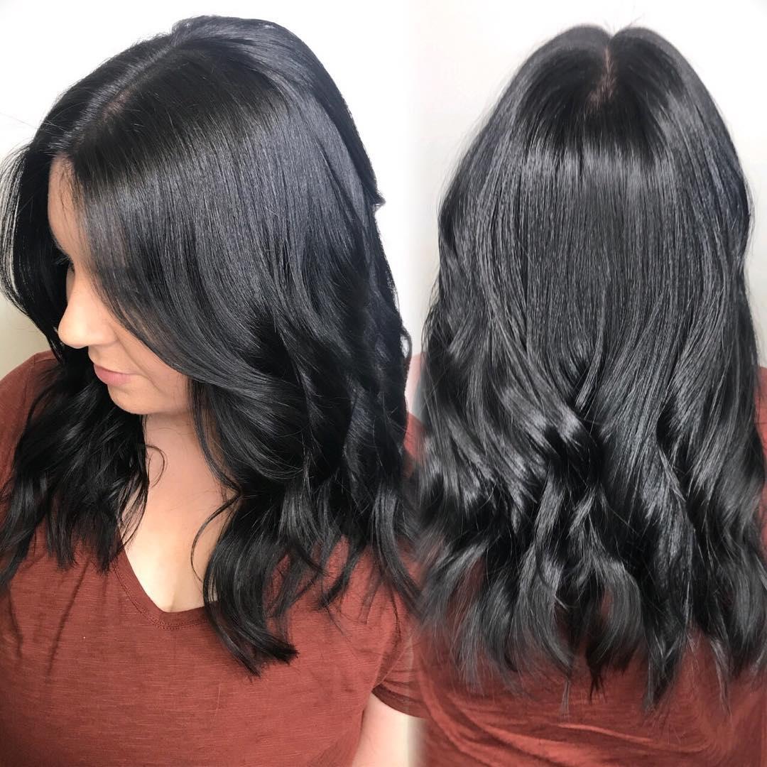 Wavy Black Layered Longhair Hairstyle
