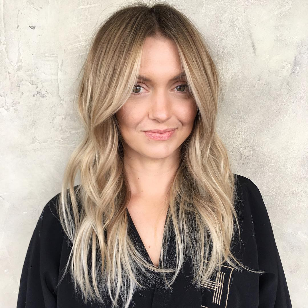 Wavy Layered Cut With Long Curtain Bangs And Soft Caramel Balayage The Latest Hairstyles For Men And Women 2020 Hairstyleology