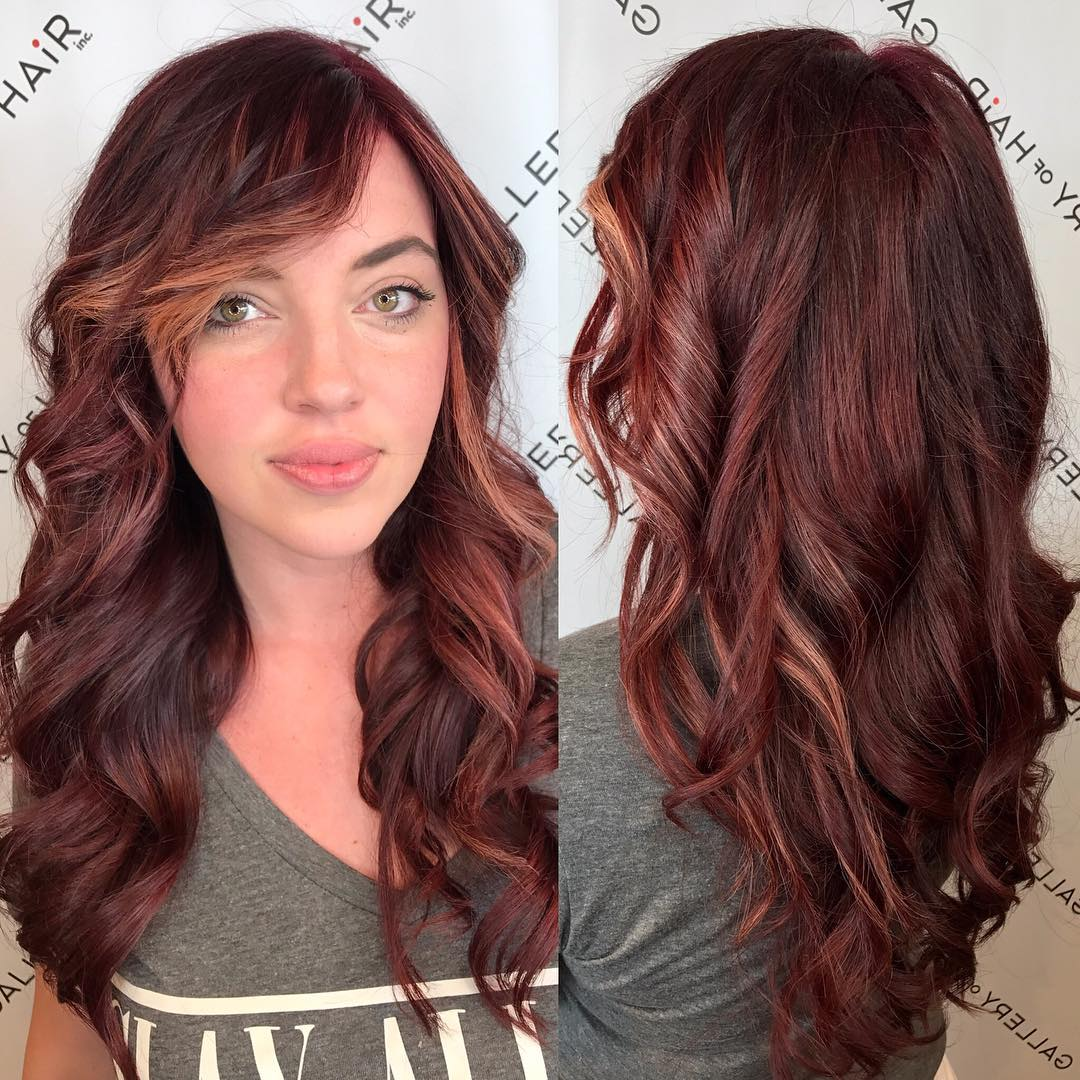 Wavy Layered Cut with Vibrant Burgundy Color and Side Swept Bangs Long Hairstyle