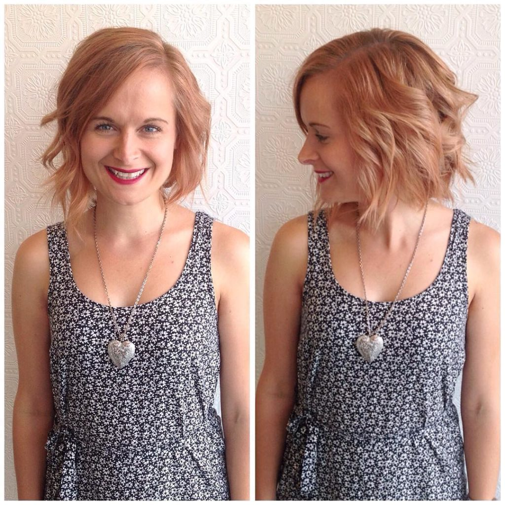 Wavy Strawberry Blonde Bob with Side Swept Bangs Medium Length Hairstyle