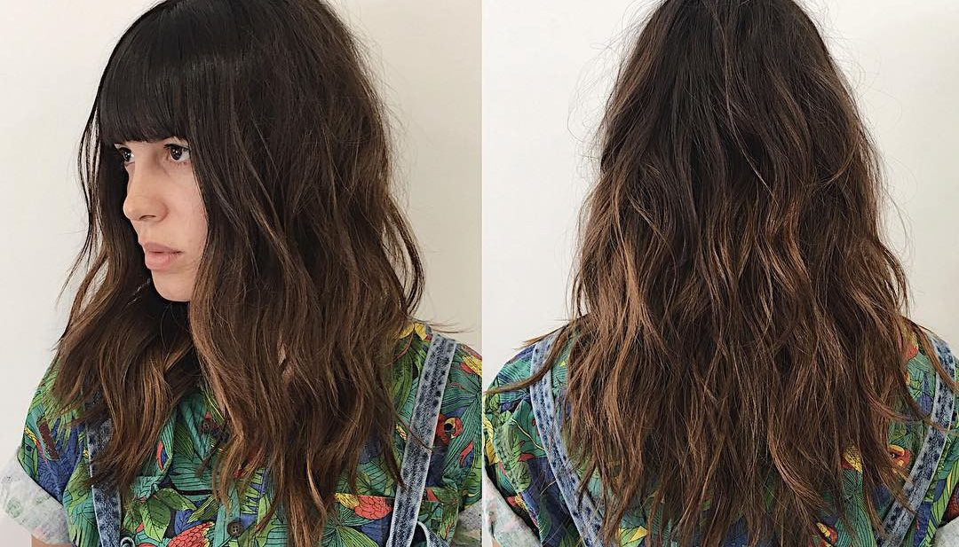 Wavy Undone Soft Layered Cut with Full Blunt Bangs and Brunette Balayage Medium Length Hairstyle