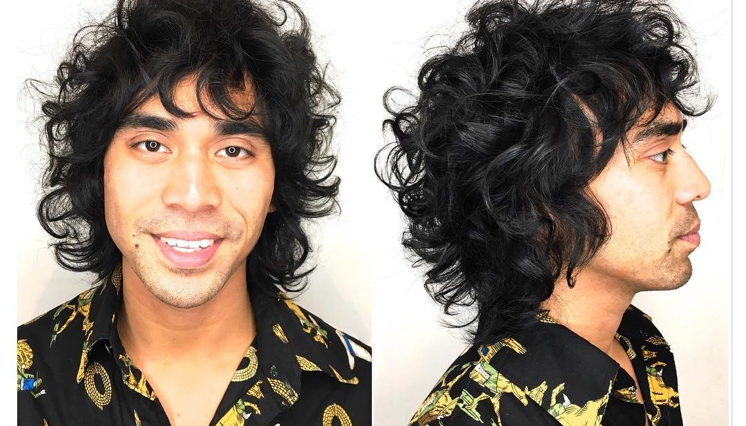 Wild Bohemian Curly Shag with Messy Texture and Jet Black Color Men's Summer Beach Hairstyle