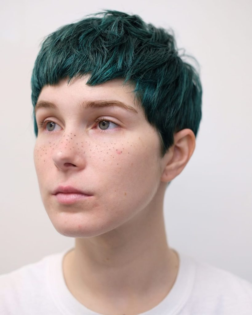 Baby Banged Cropped Pixie with Messy Texture and Dark Jungle Green Hair Color Short Fall Hairstyle