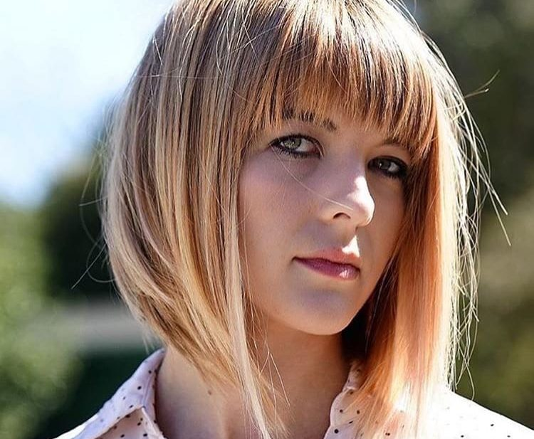 Long A Line Bob with Brow Skimming Fringe Bangs and Strawberry Blonde Color with Highlights