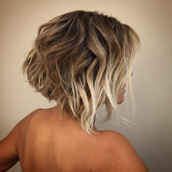 Short Angled Bob with Blonde Balayage Color and Messy Textured Beach Waves