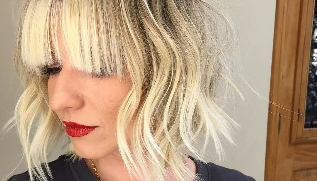 Long Blonde Bob with Choppy Layers and Full Bangs