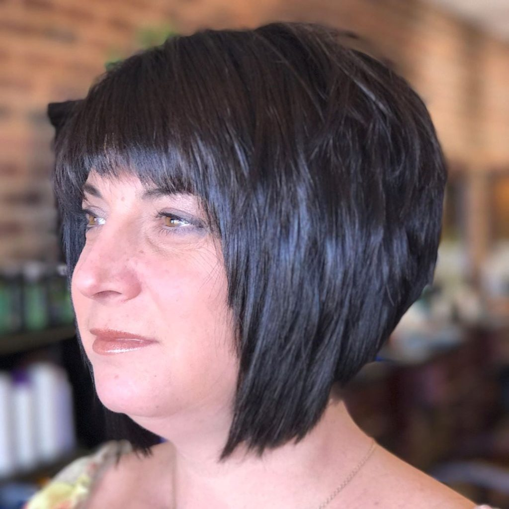 Short Black Angled Bob with Choppy Layers and Choppy Brow Skimming Bangs
