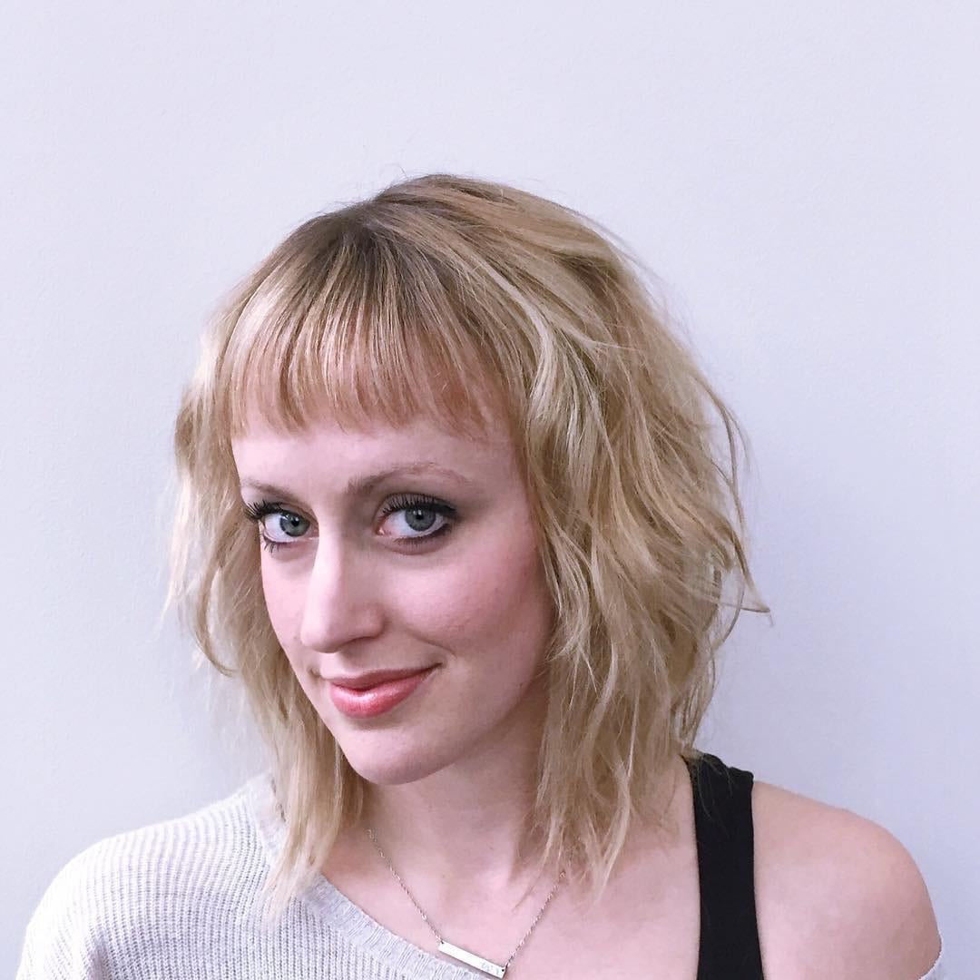 Long Blonde Bob with Wavy Texture and Baby Bangs