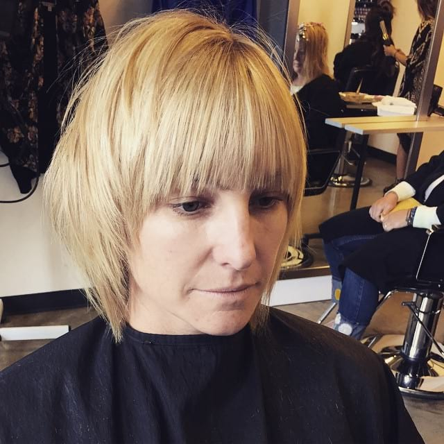Short Blonde Shaggy Bob with Face Framing Textured Ends and Full Bangs