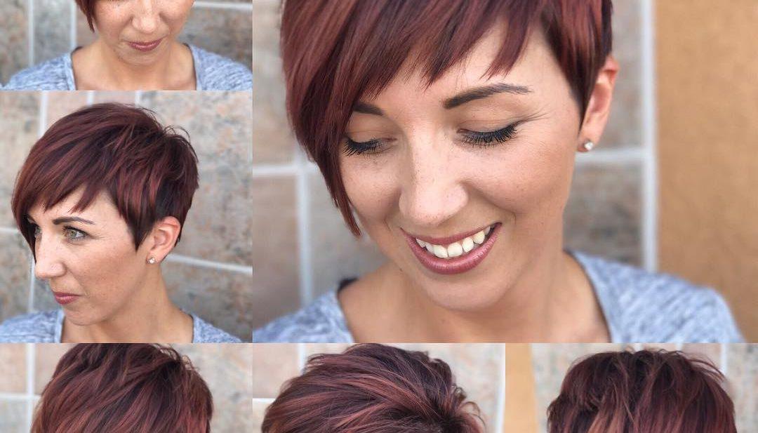Shaggy Asymmetrical Pixie with Asymmetrical Bangs on Highlighted Burgundy Hair
