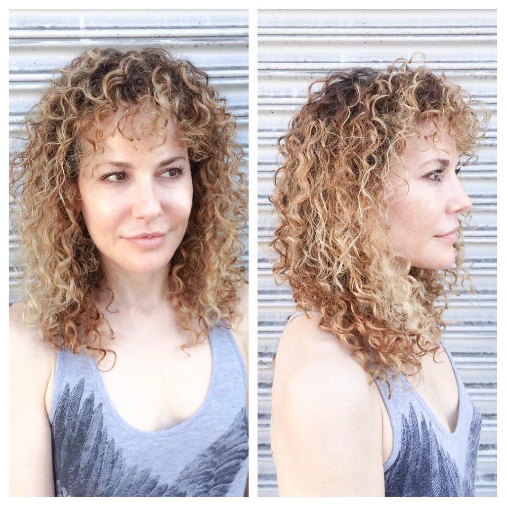 Blonde Balayage Curly Hair with Bangs