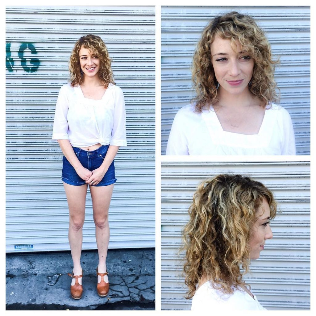 Shoulder Length Curly Bob with Side Swept Bangs and Balayage