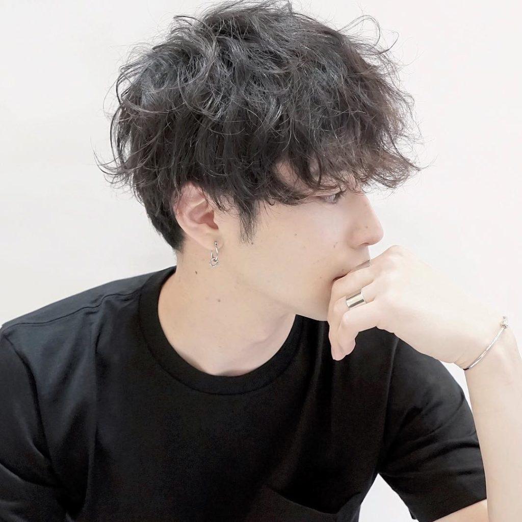 Overgrown Regular Cut with Long Messy Wavy Top Lengths on Dark Hair