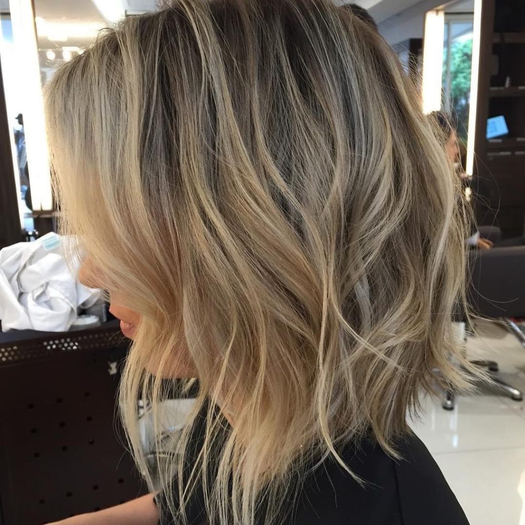 Long Shaggy Angled Bob with Tousled Waves