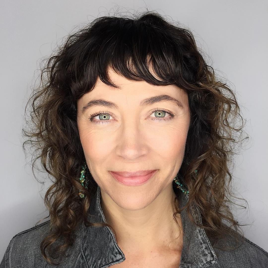 Curly Hair with Short Pieced Fringe Bangs on Brunette Ombre Hair