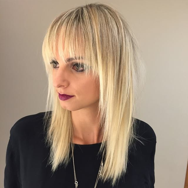 Long Blonde Shaggy Layered Cut with Fringe Bangs