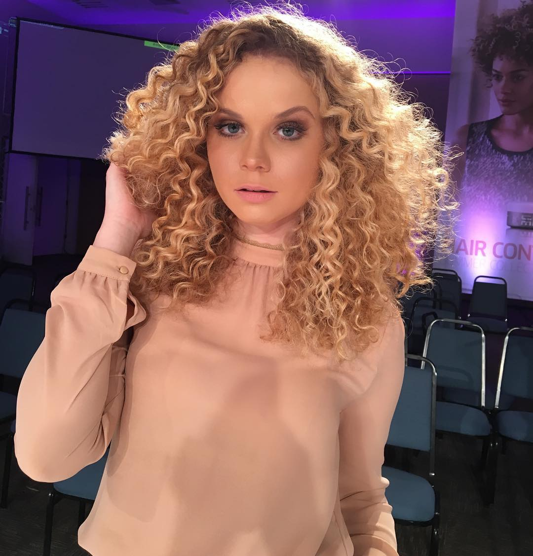 Long Layered Hair with Spiral Curls on Strawberry Blonde Hair with Dark Roots