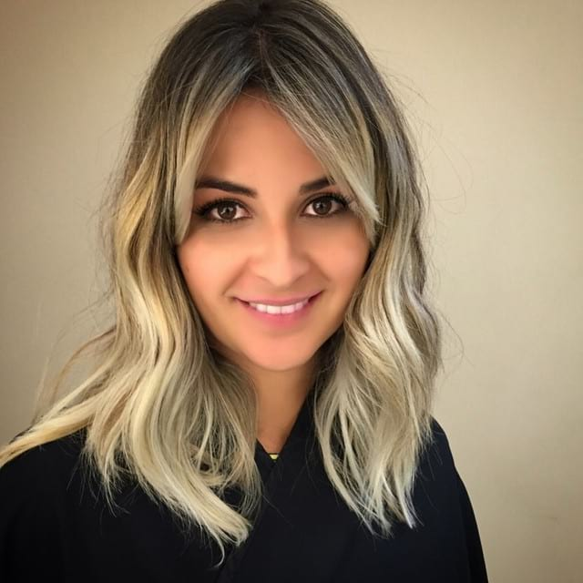 Long Wavy Hair with Center Parted Side-Swept Bangs