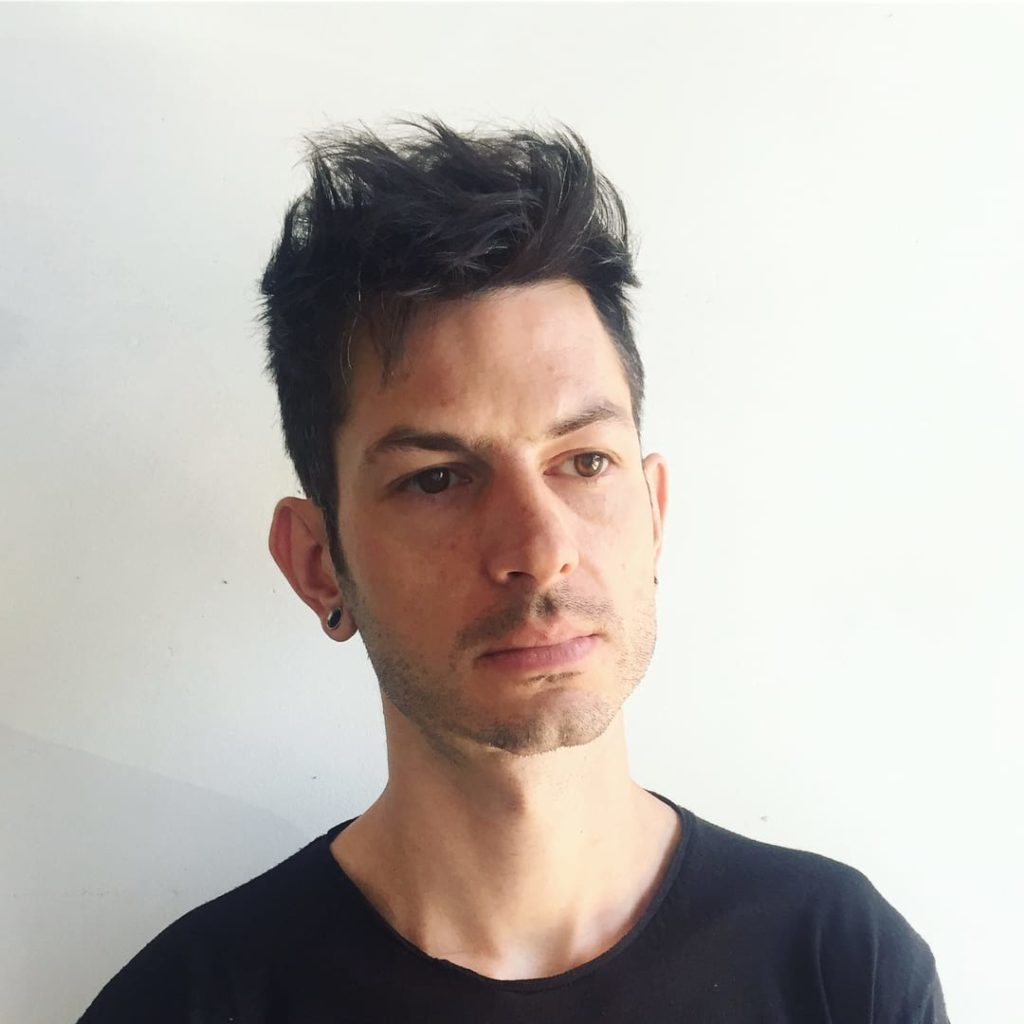 Mens Medium Messy Brushed Up Textured Top Lengths with Tapered Sides on Black Hair