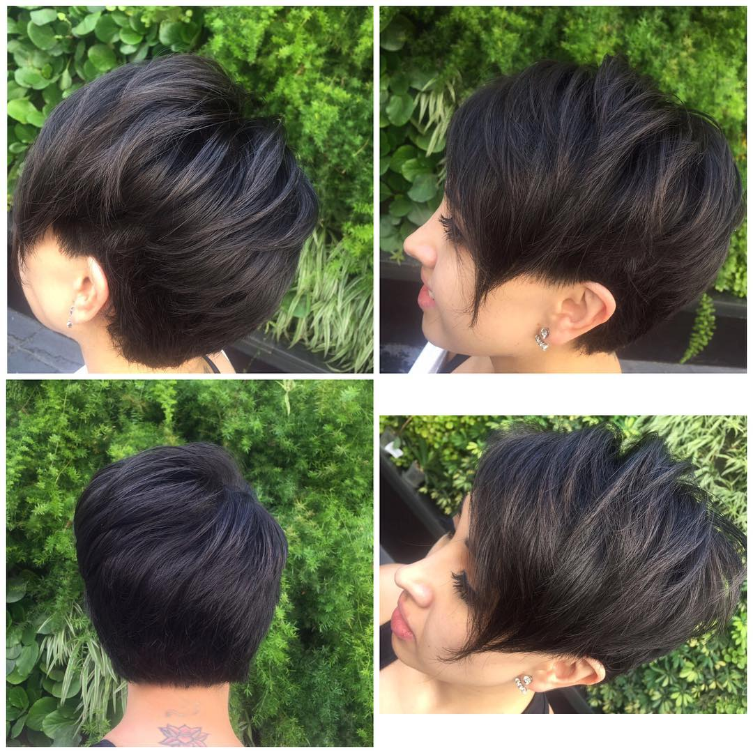 Short Voluminous Textured Pixie with Side Swept Face Framing Layers on Dark Hair