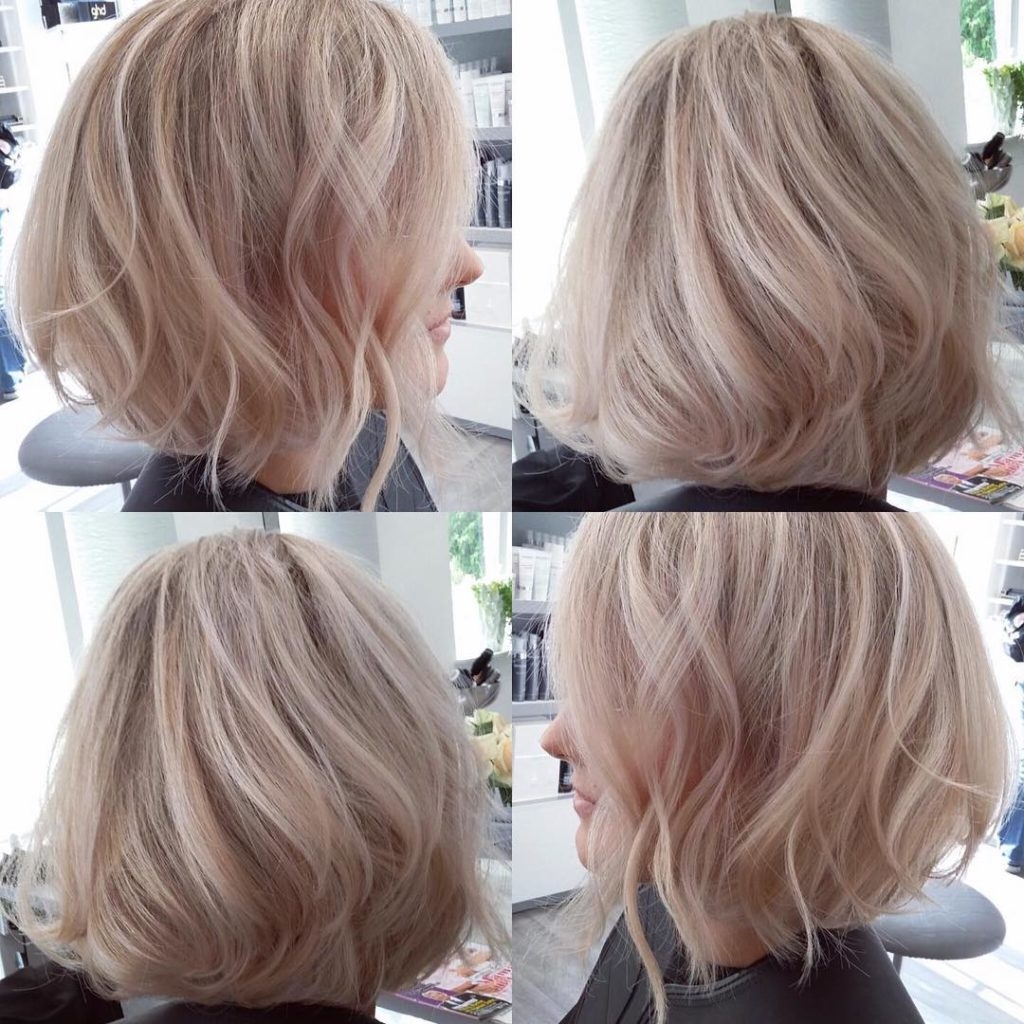 Blowout Angled Bob with Tousled Waves on Blonde Hair with Platinum Highlights