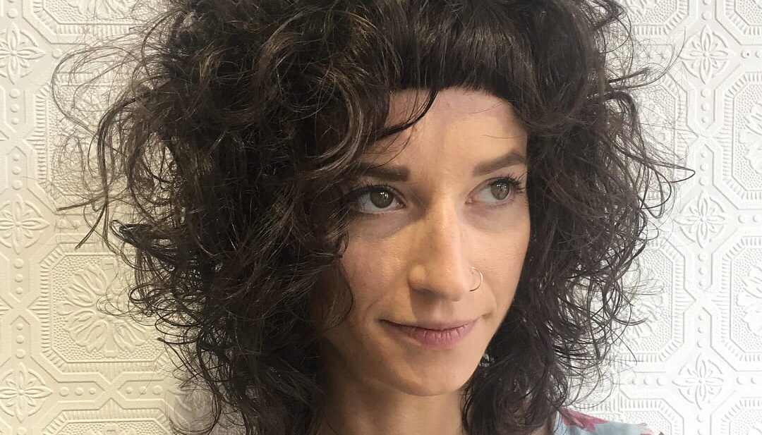 Messy Textured Curly Bob with Micro Bangs on Brunette Hair