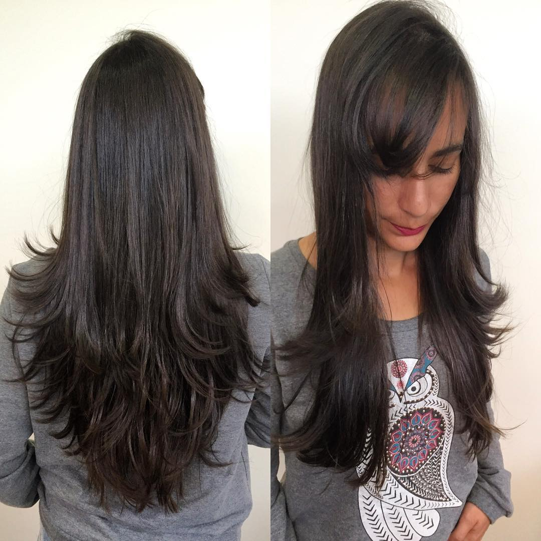 Longhair with Short Razor Cut Layers and Side Swept Bangs on Dark Brunette Hair
